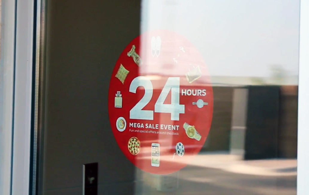 A window stick decal on showing a 24 Hour Mega Sale Event