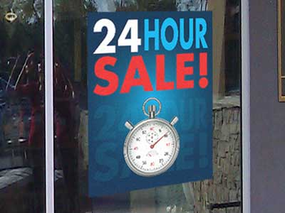 A Store front graphic of a 24 Hour Sale on a window of a clothing store