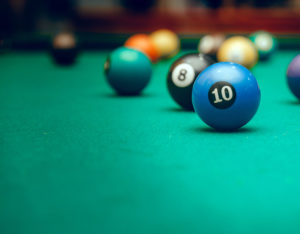 a set of balls laying on a billiard table