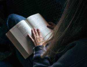 A lady reading a poetry book